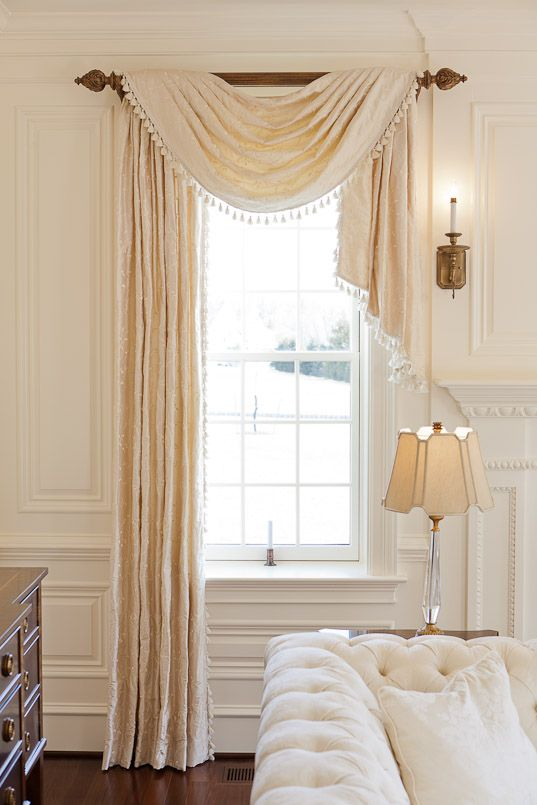 one side panel + draping scarf valance, love this bedroom window treatment