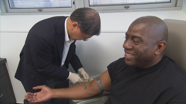 HIV in America- statistics amoung african american population rising    Dr. David Ho, an HIV/AIDS specialist, draws blood from Magic Johnson, one of the people featured in Endgame: AIDS in Black America.