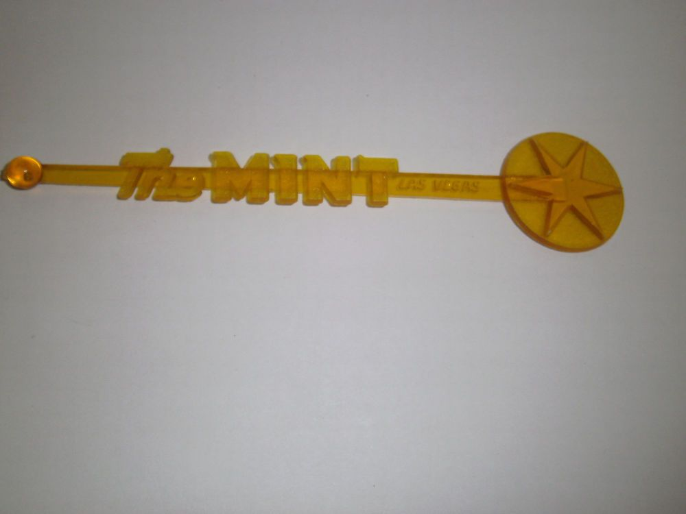 The Mint Hotel Las Vegas Drink Swizzle Stick Stir Stirrer Clear Yellow Plastic