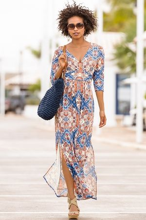 """When the occasion calls for a head-turning dress, this bold print maxi is a must-have pic. From the sexy surplice neckline, the banded waist that shapes and flatters, and the sexy side slits that offer a glimpse of leg, this diamond tile maxi dress is figure-flattering and captivating.• Polyester/spandex.• Imported.• Machine wash or dry clean.• Sensuously shaped: skims the body.• Maxi: 57""""-58"""".• Sizes 0-18."""