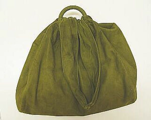 Green purse, 1945. Suede and  synthetic materials. John Frederics designer, American. Bags became larger to hold gas masks.