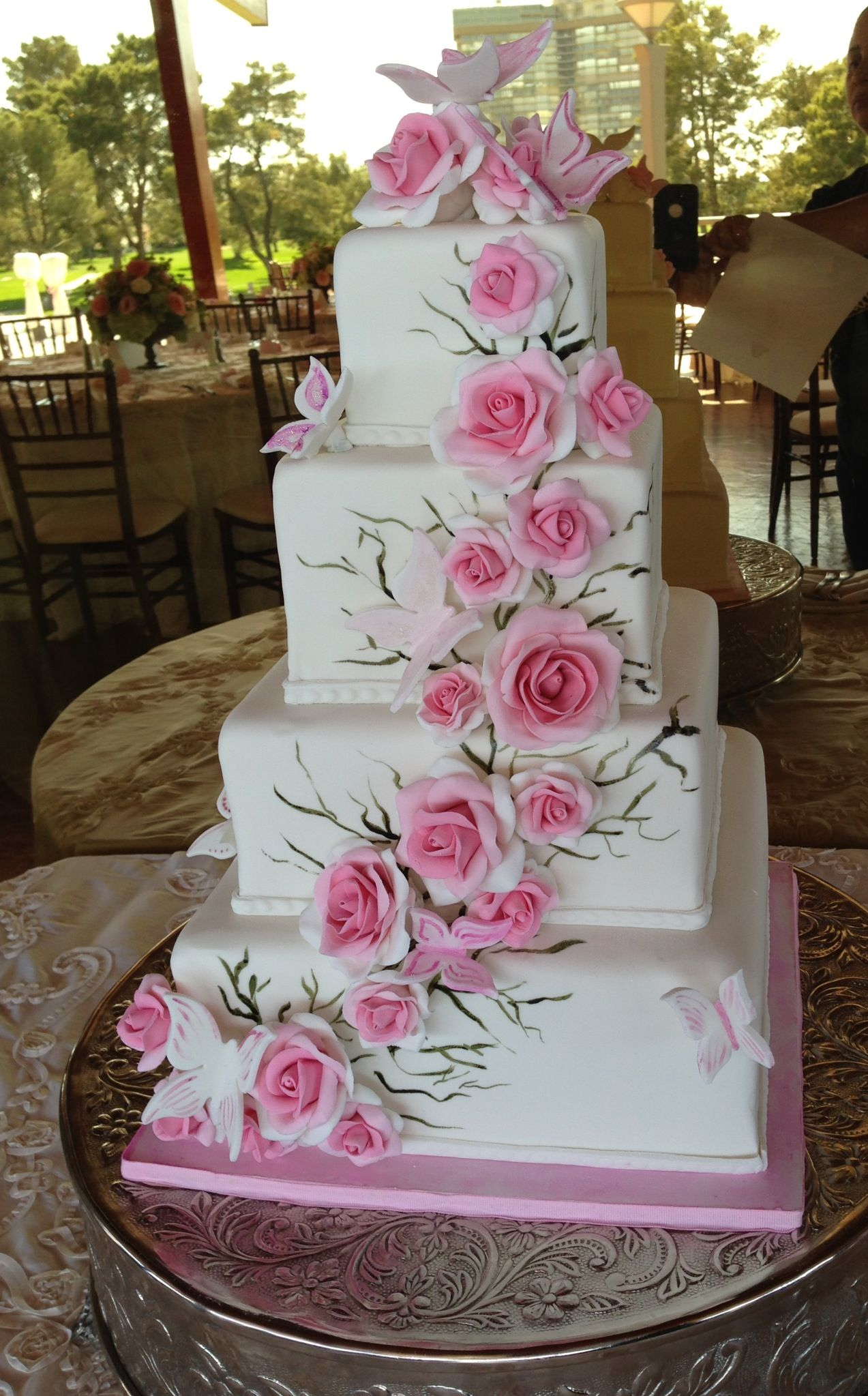 Romantic roses and Butterflies. Pretty in pink! A beautiful wedding cake.  http://www.sweetlucysconfections.com/Sweet_Lucy_Confections/HOME.html