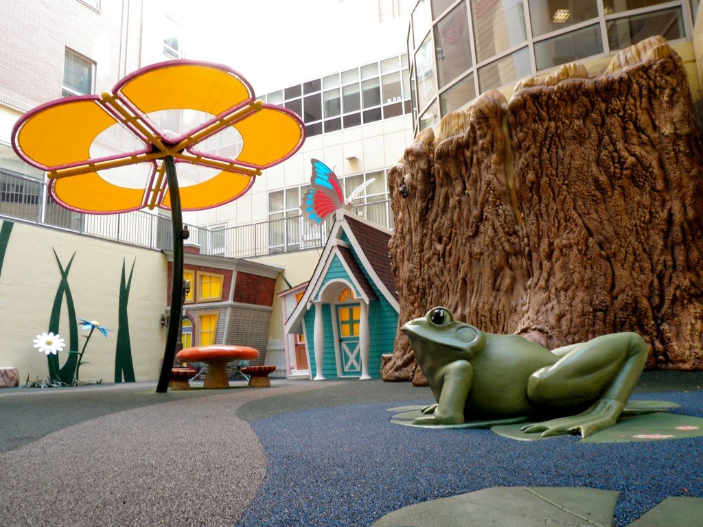 Rainbow Babies & Children's Hospital - Cleveland, OH    The Rainbow Babies Healing Garden is a whimsical themed outdoor (courtyard) environment for children and families to come and relax.     The garden features a brownstone house puppet theatre, a cottage storage building, giant tree stumps and a beanstalk, themed seating and giant shade flowers.