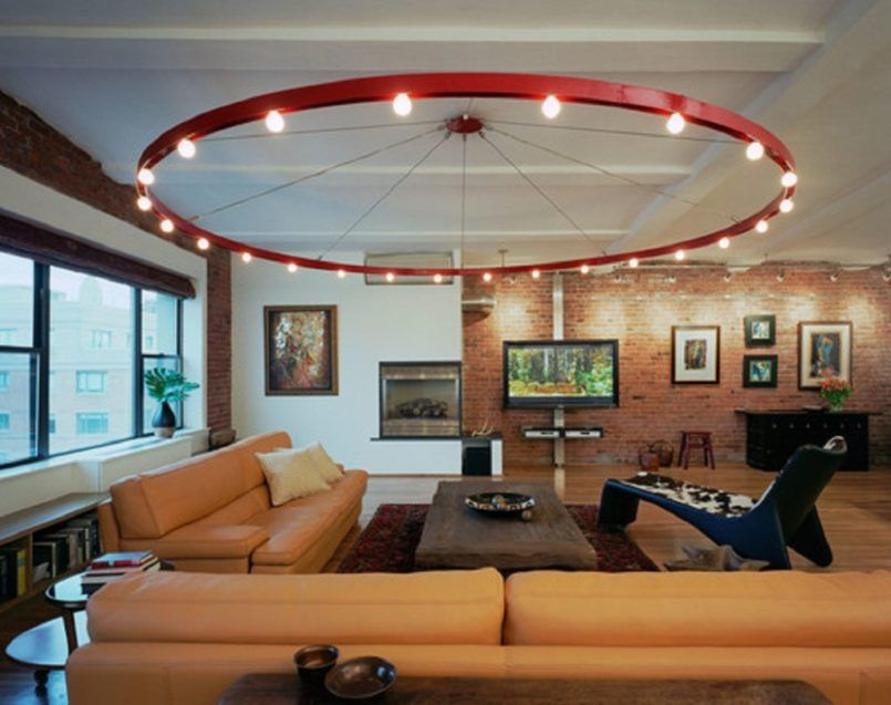 Interior Round Track Lighting Living Room With Light Brown Upholstery Sofa Rectangle Wooden Table On Fl Patterned Rug And Side