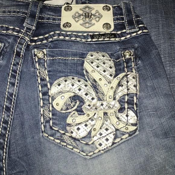 Miss Me jeans! Size 26 31 miss me jeans. No wear on bottoms at all. In perfect worn condition. Light wash signature boot. Miss Me Jeans Boot Cut