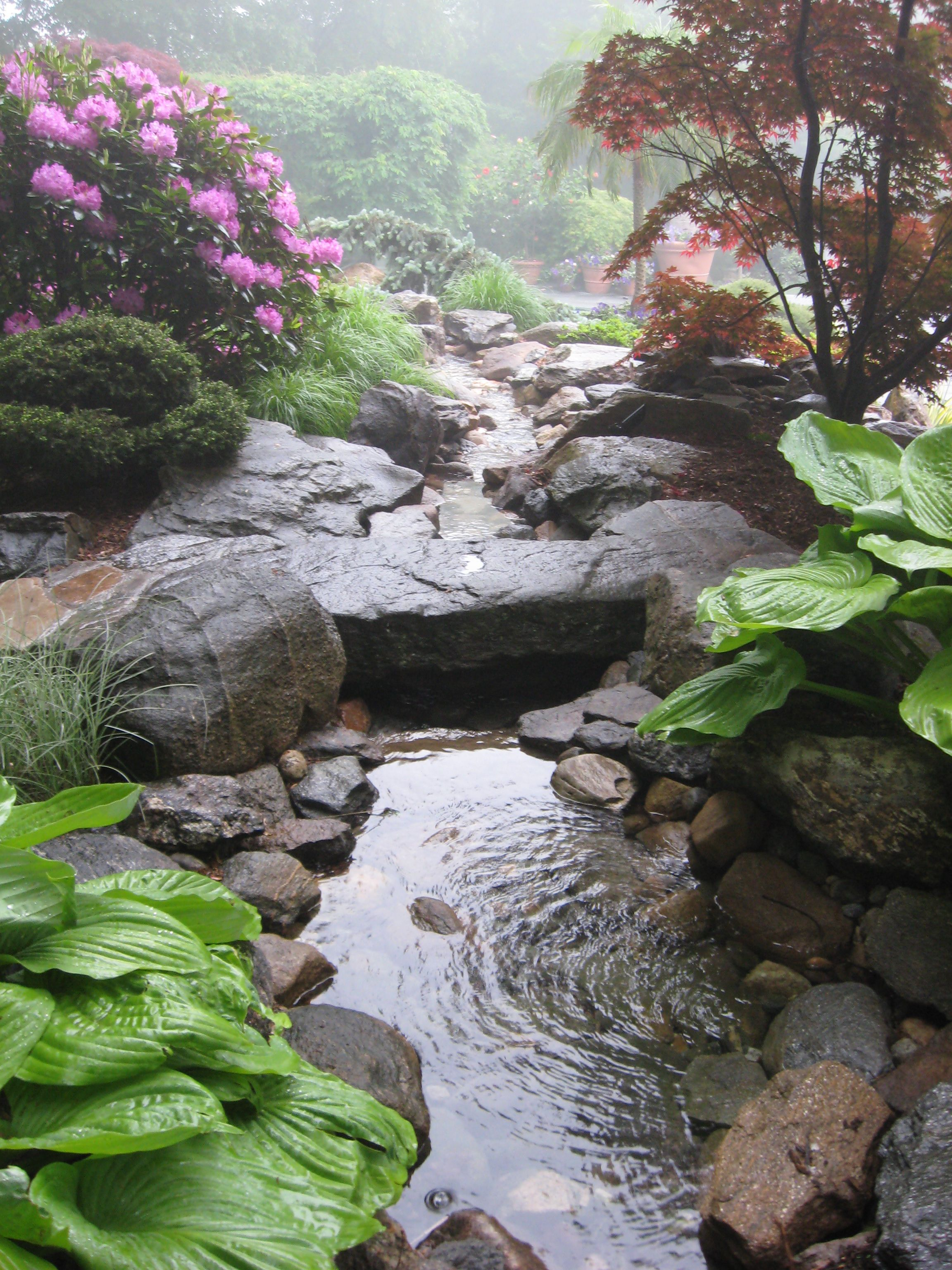 Backyard Waterfalls Water Garden Stream With Stone Bridge In A - garden pond designs waterfalls