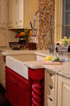 Red base cabinet with a farmhouse sink.