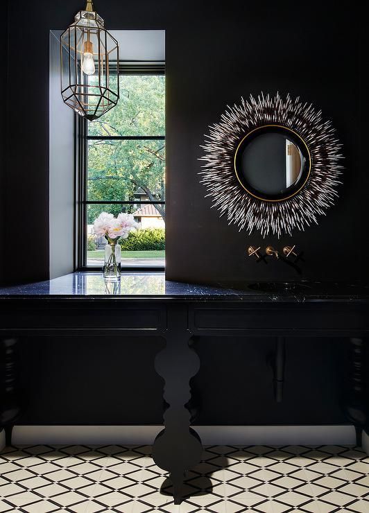 Contemporary Chic Black Powder Room Clad In Ivory And Black