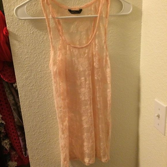Wallflower lace see through tank A great lace tank! It's a sherbet orange color! A great basic top! The tag says large but I am a small and it fits me tight! Tops Tank Tops