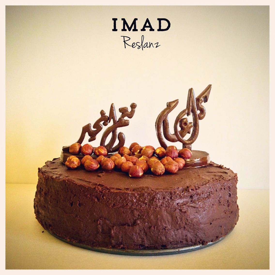Chocolate cake with chocolate cake toppers in Arabic