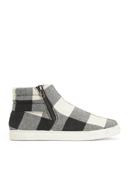 Hip and stylish street wear inspired hi-top slip-on sneaker Great with skinny denim or leggings Adds an edgy vibe to your ensemble Side zipper closure Quilted top line Round toe Gunmetal hardware Lightly cushioned footbed