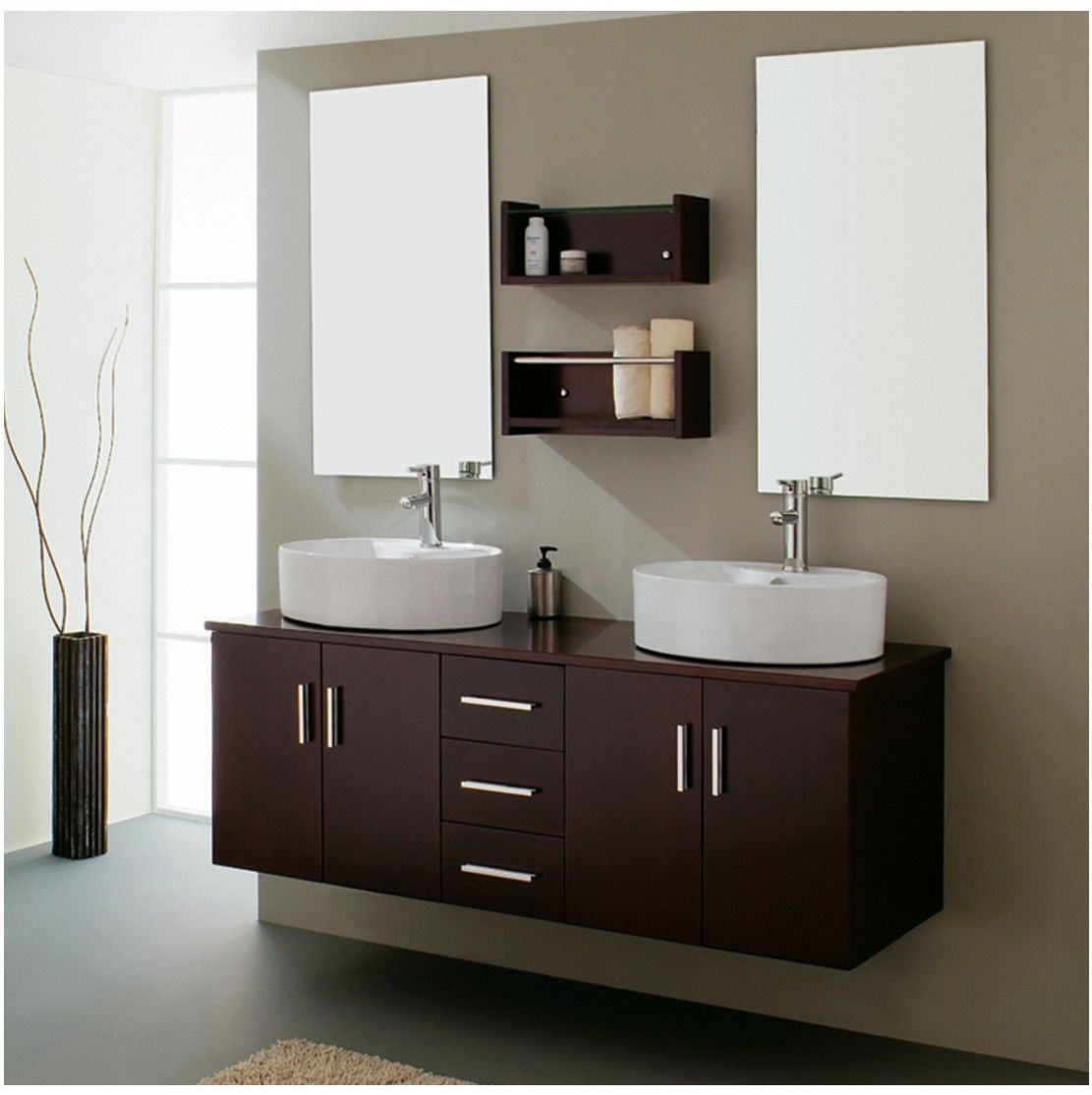 A modern minimal bathroom with clean lines architecture and appealing two oval white vessel sinks idea completed with metallic faucets mounted on espresso bathroom vanity use jk to navigate to previous and next geotapseo Choice Image