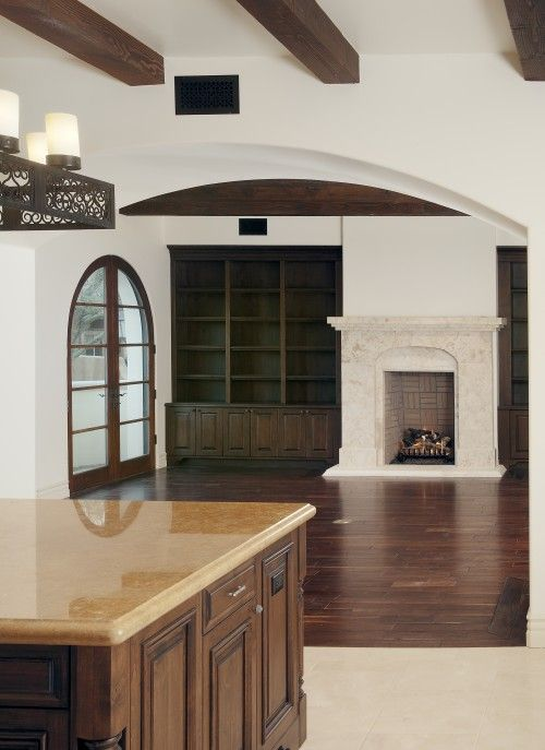 fireplace, built-ins, arch, wood floors, beams STYLE SOUTHWEST