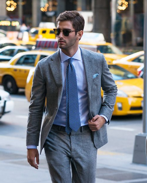 Suit, shirt, tie and shades.