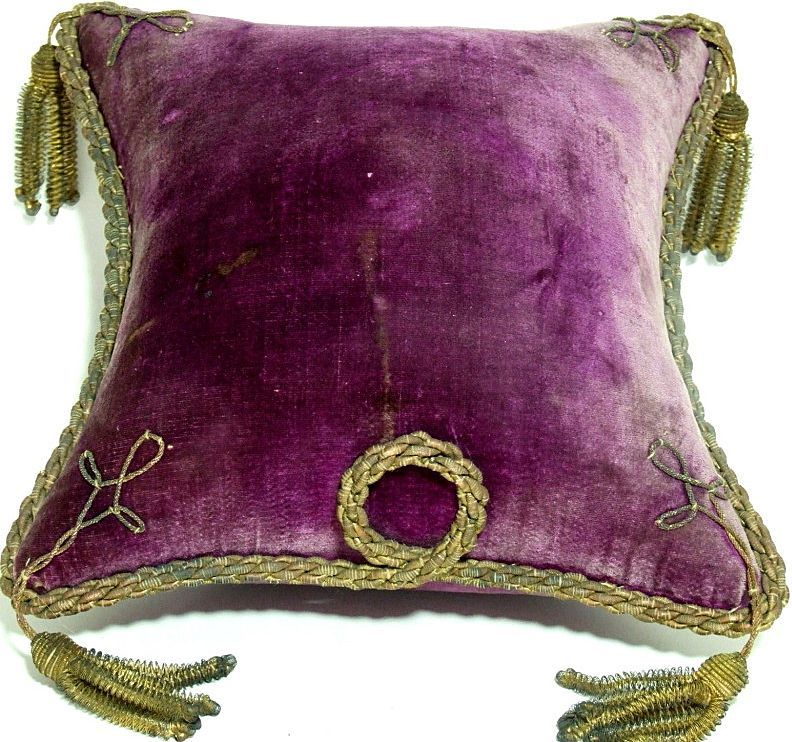 Opulent antique French Display Pillow. Designed for jeweled Crown / Tiara Display.  Royal Purple silk velvet over a hard horse hair stuffing. Beautifully decorated with antique gold bullion trim and tassels. Dating from circa 1850. #crowntiara