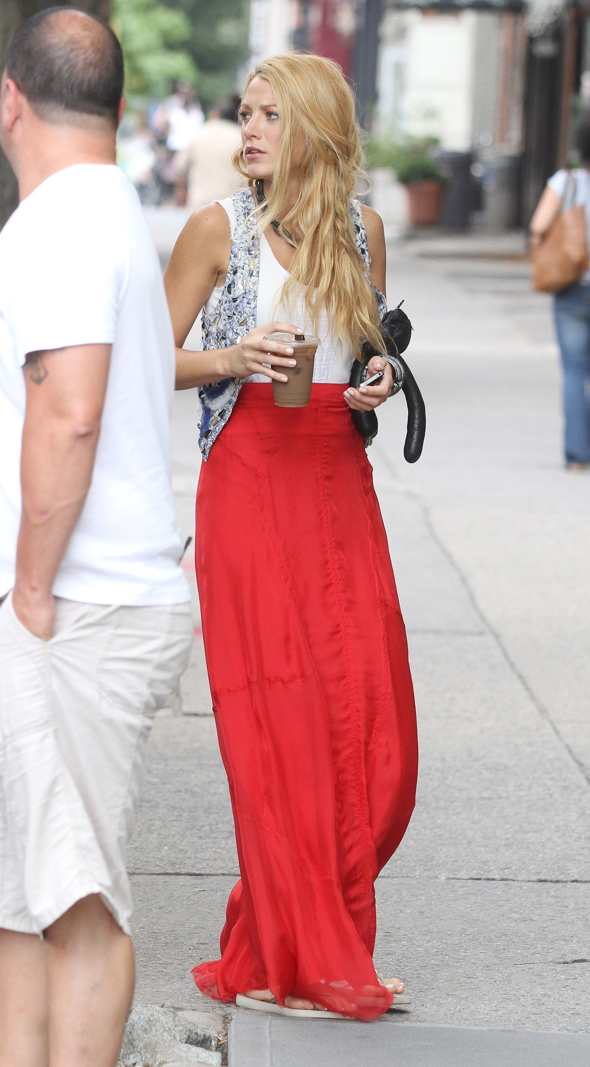 Perfect red skirt styled with vest and a beautiful hair style