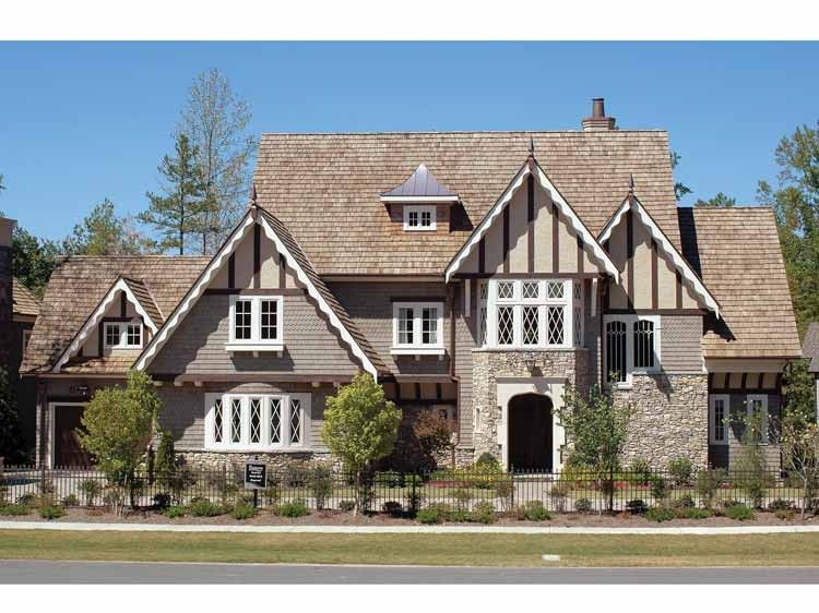 Queen anne house plan with 4934 square feet and 4 bedrooms for Historic tudor house plans