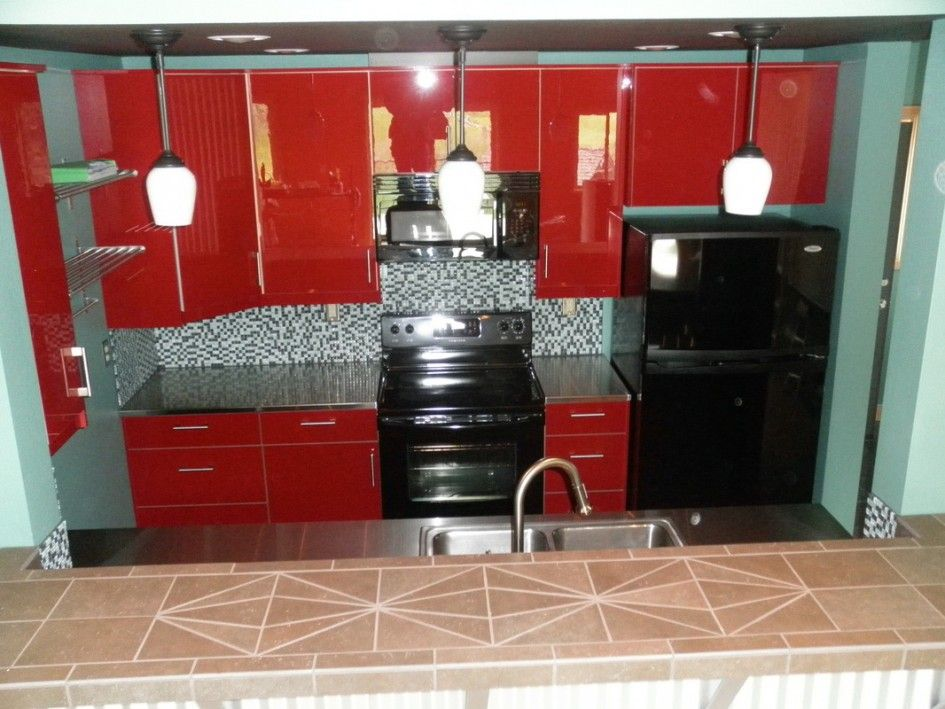 Glossy Red Painted Kitchen Cabinet With Black Countertop ...