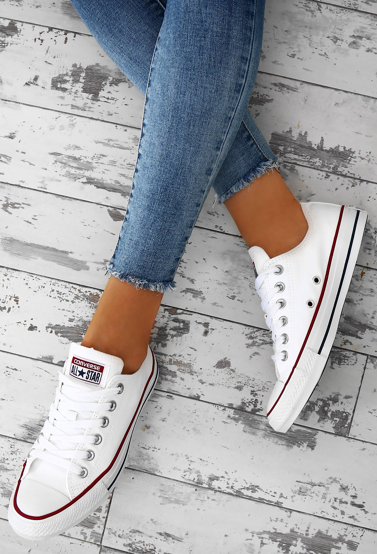 ea49700b3b62 Every girl needs a pair of Converse All Stars in her wardrobe! These  classic white Converse trainers feature a rubber capped toe and branding on  the back.