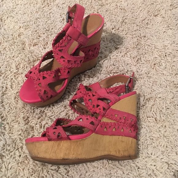 Gianni Bini Pink Wedges Size 7.5 Gianni Bini pink cut out leather wedges. These definitely have some wear and tear, but they are soooo cute on! A little dirty, but still great condition Gianni Bini Shoes Wedges