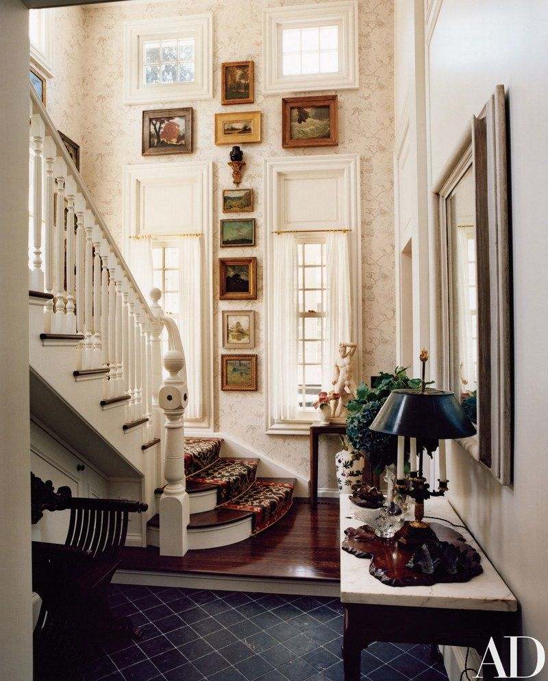A Collection Of American Impressionist Landscapes Hangs In The Main Stair Hall Thomas O Brien S New Long Island House Wallpaper By Gp J Baker For Lee