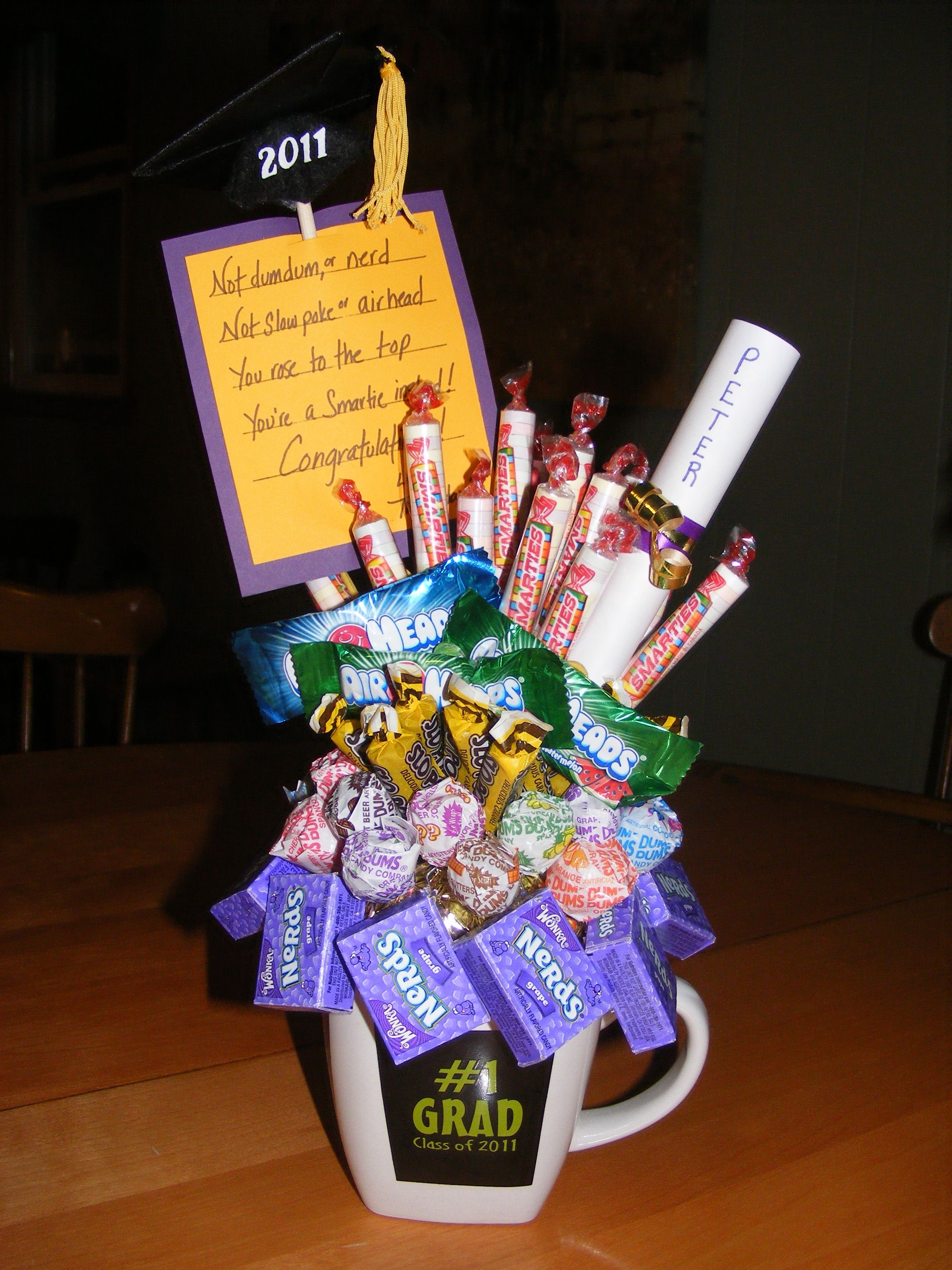 A candy bouquet for a grad. I made this for our babysitter's son and it was a hit!