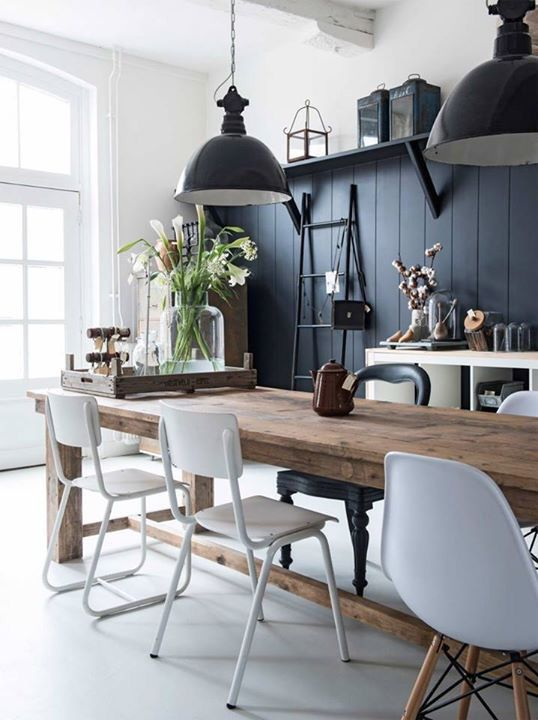 Blue walks timber flooring mismatched chairs and hanging lights