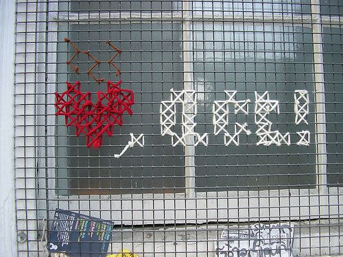 Cross-stitch Graffiti (Craftivism). I really love this as an idea: advertisements; prayer activity; decoration.