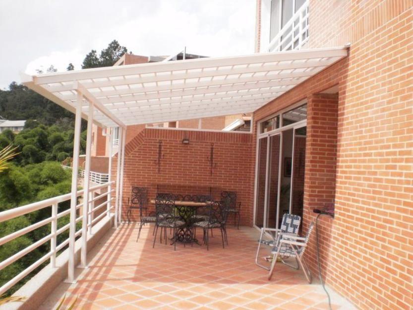 Trabajos de remodelacion en general techos para terrazas for Casas de madera para patios
