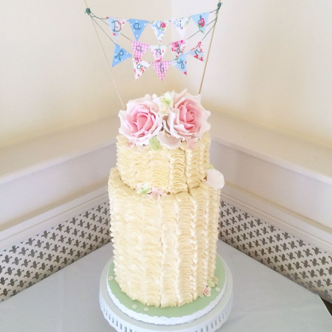 Double height two tier buttercream ruffle wedding cake, with ...
