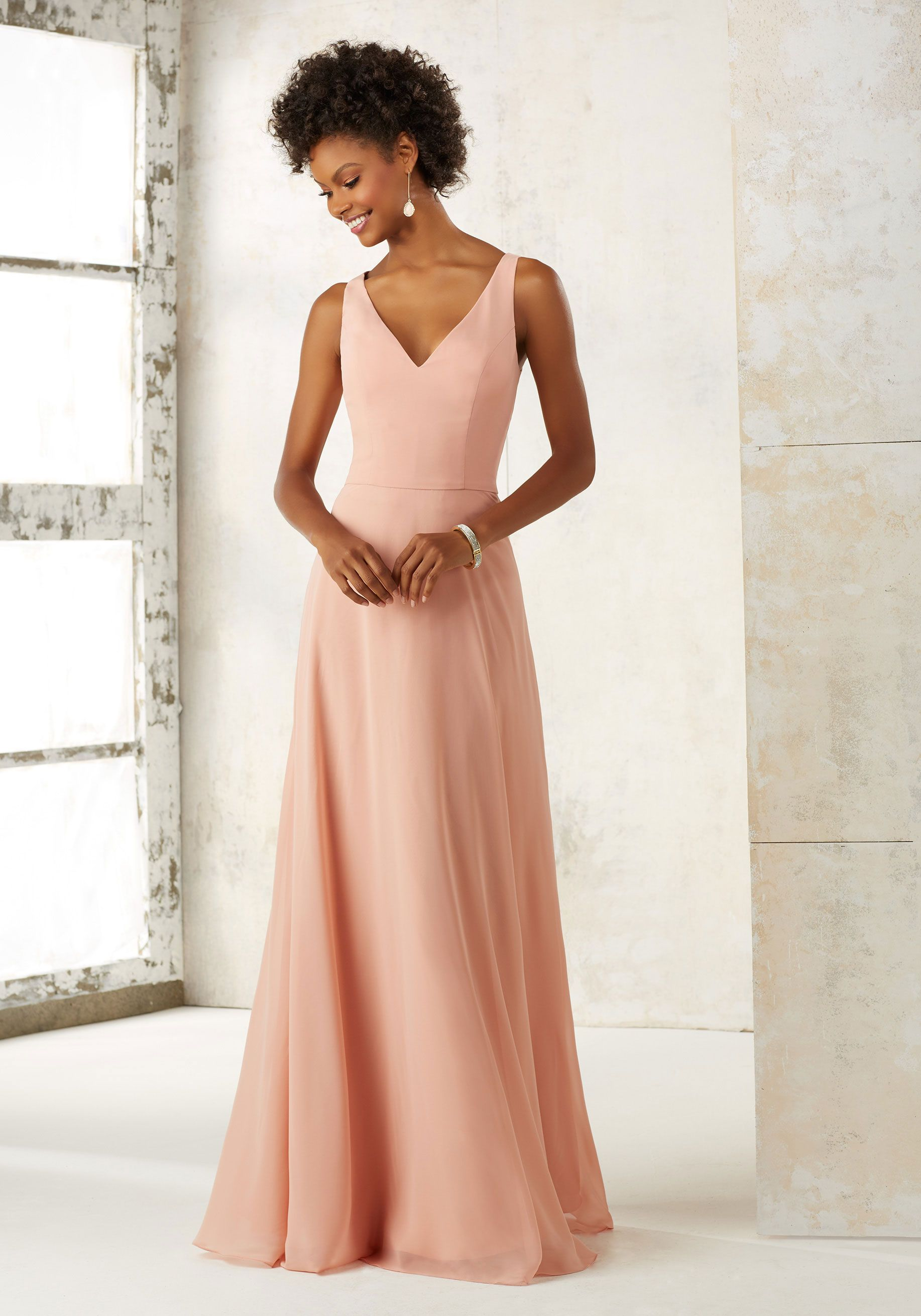 554ecae94a This Sleeveless A-Line Chiffon Bridesmaids Dress Features a V Neckline and  Draped Overlay Back. Shown in Peach