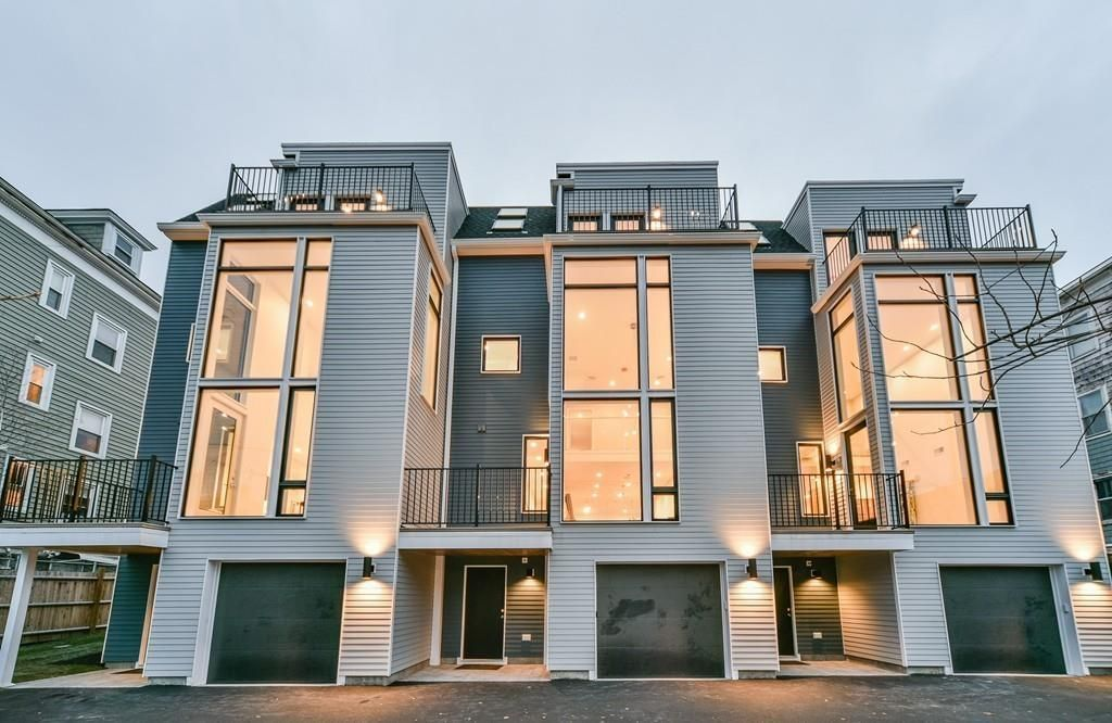 Amazing New JP Townhouse Includes 20 Foot Wall Of Glass