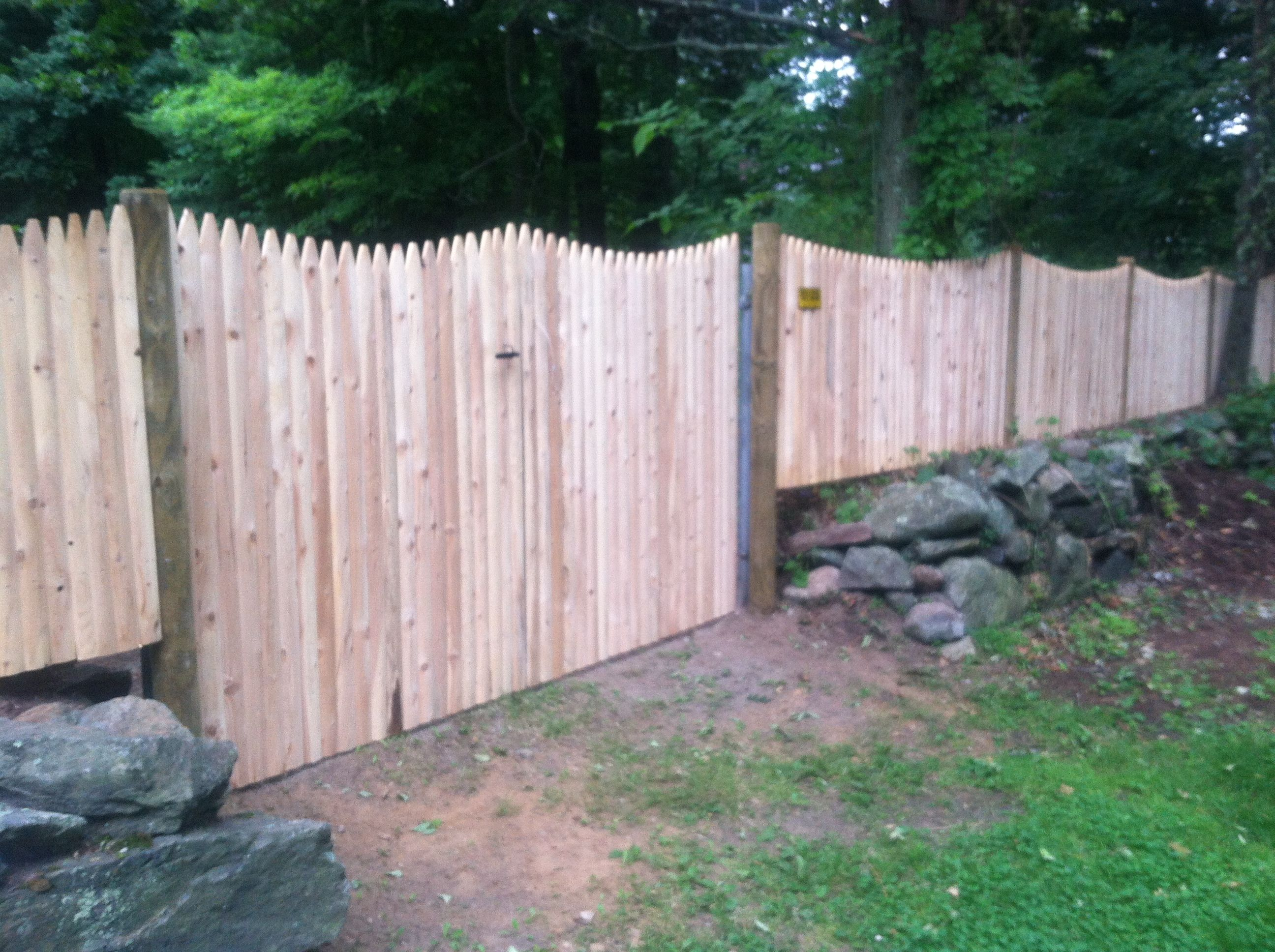 Scalloped Cedar Stockade Fence With Double Gate And Round Pressure Treated Posts Stockade Fence Fence Landscaping Outdoor Garden