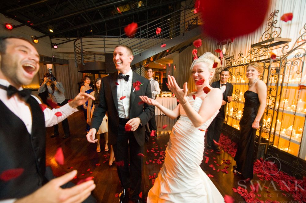 Planned, Designed & Produced by www.swankproductions.com Candlelight Wedding at Tribeca Rooftop. Bride In Her White Wedding Dress Throwing Red Rose Petals #ROSE #PETALS #BRIDE #GROOM #WHITE #WEDDING #DRESS #BRIDAL #GOWN #ANDLELIGHT #WEDDING #TRIBECA #ROOFTOP #WEDDING #INSPIRATION #IDEAS #DECOR