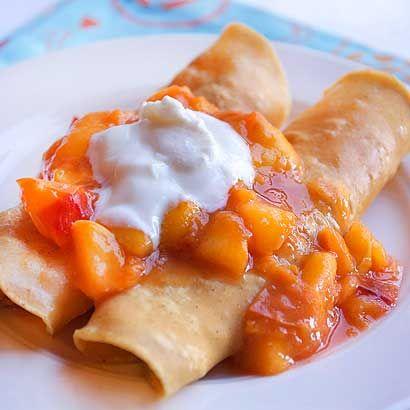 Peach pie enchiladas!  With summer peach sauce, cream cheese and corn tortillas.