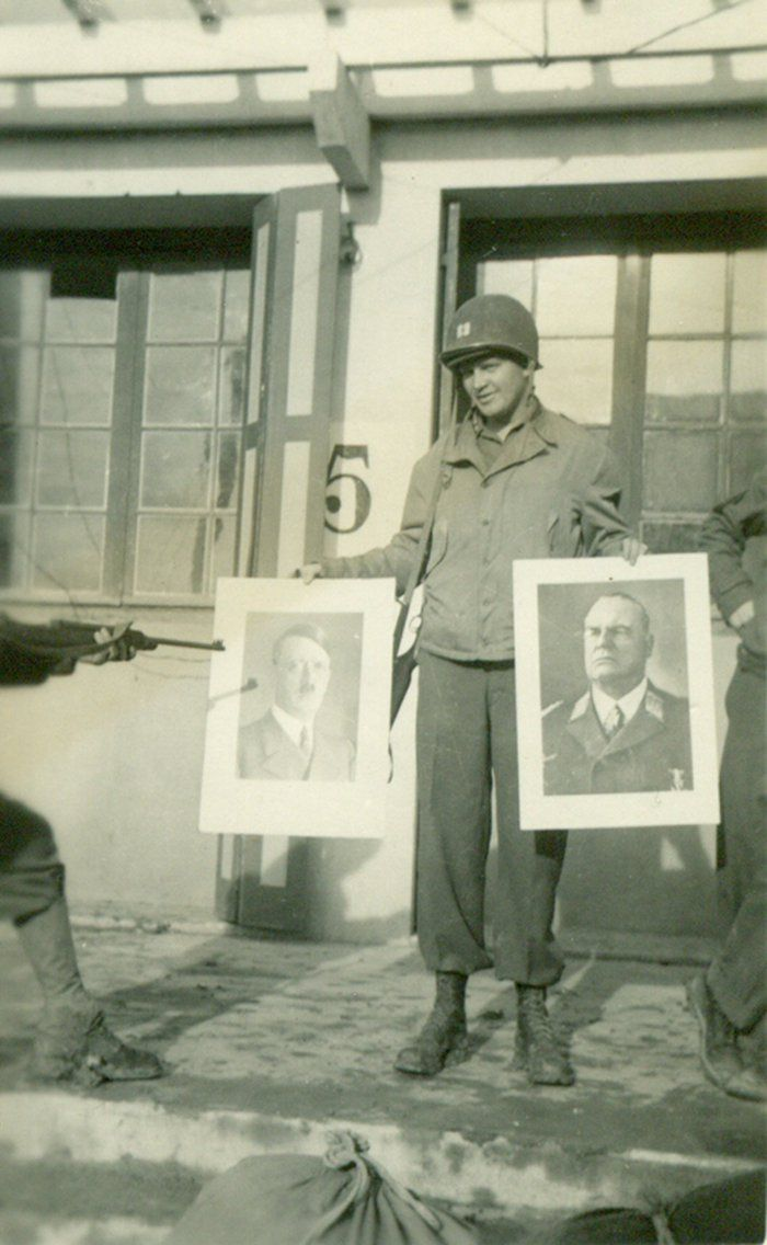 """Bomb Group 394. """"We used the building for our headquarters and in two separate rooms I found large photos of Hitler and Goering. Capt. Gaskell is holding them! Orleans, France - 1944"""". Contributed by Clyde Reinsch"""