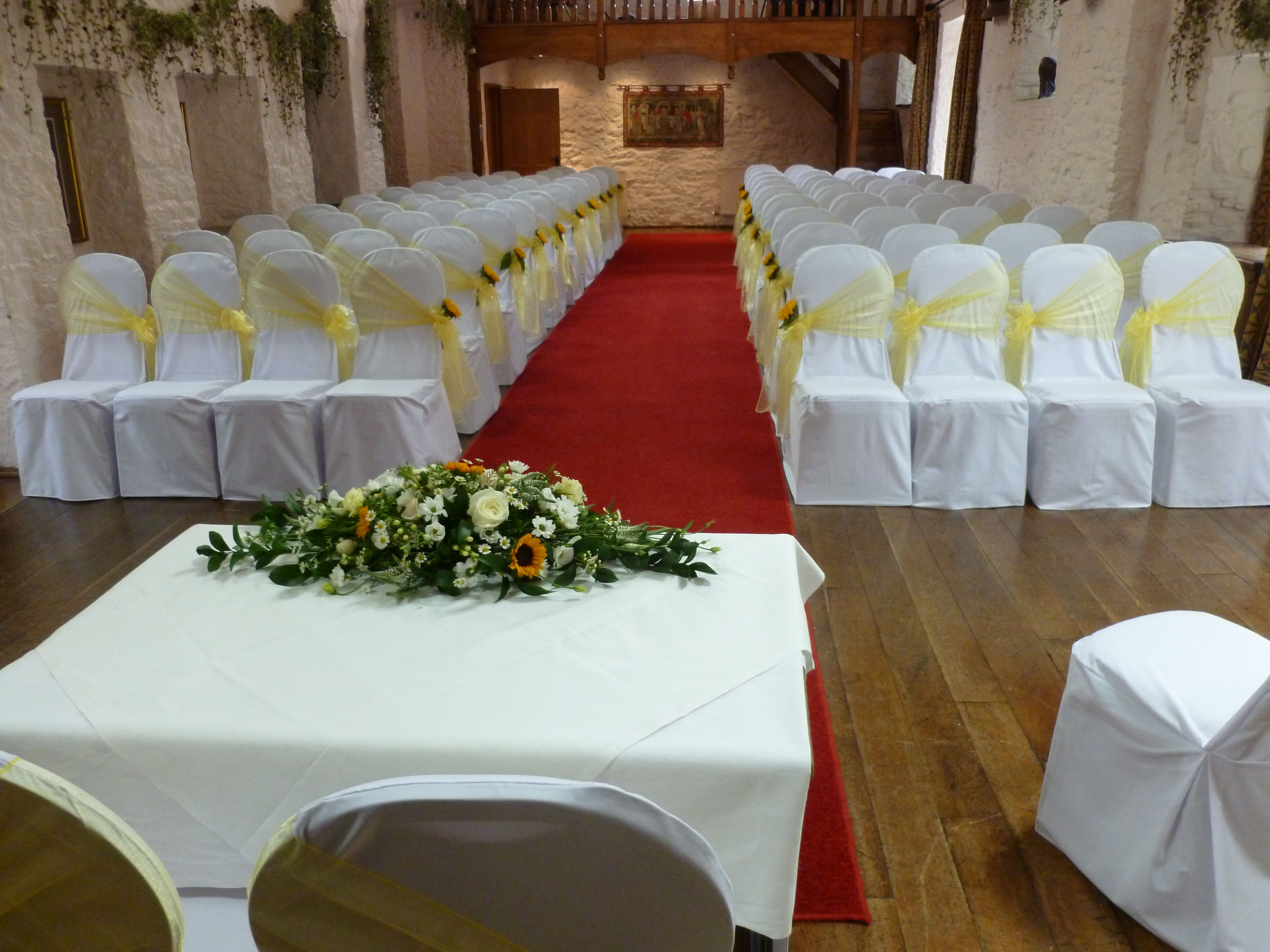 lemon chair sashes with sunflowers at miskin manor by simply bows