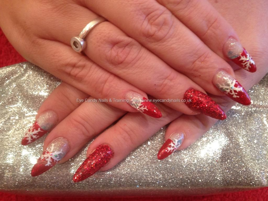Stiletto nails with red glitter and snowflakes as #nail art #NailArt ...