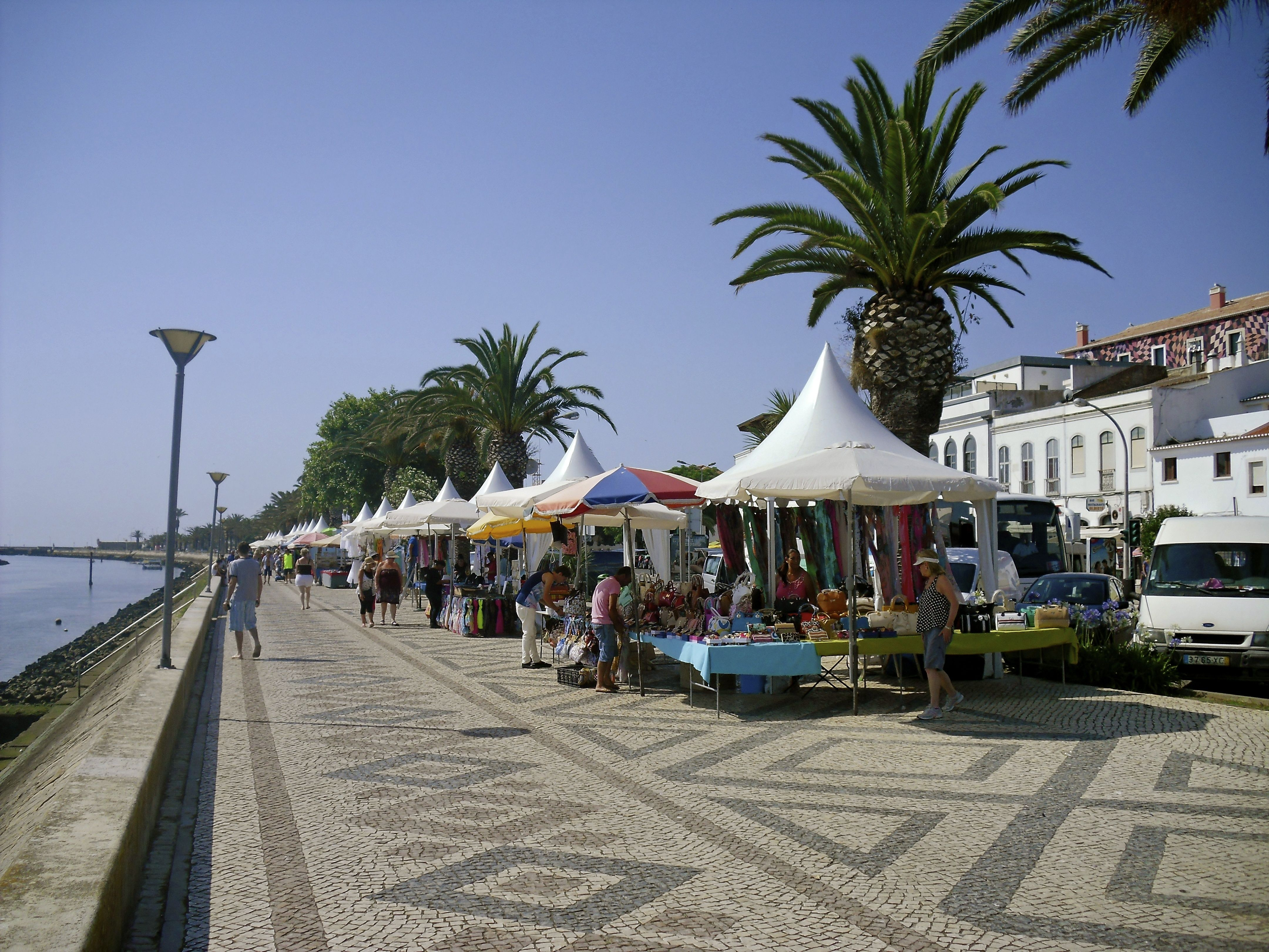 Local business's set up shop on the large promenade opposite the Marina during peak season - offering anything from sun tan lotion to local art work @visitportugal @enjoyportugal