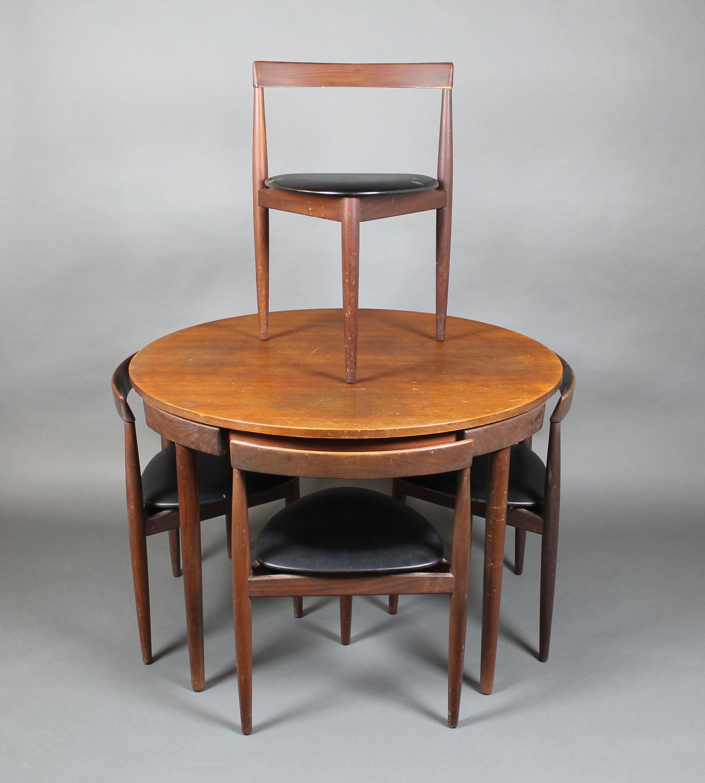 "Lot 932 Hans Olsen A 1950 s teak "" pact"" circular dining table"