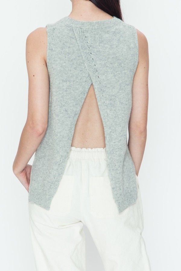 this sweater is so fun! This sleeveless sweater would be cute paired with our Olive Bralette or over a maxi dress for a fun transition look!!