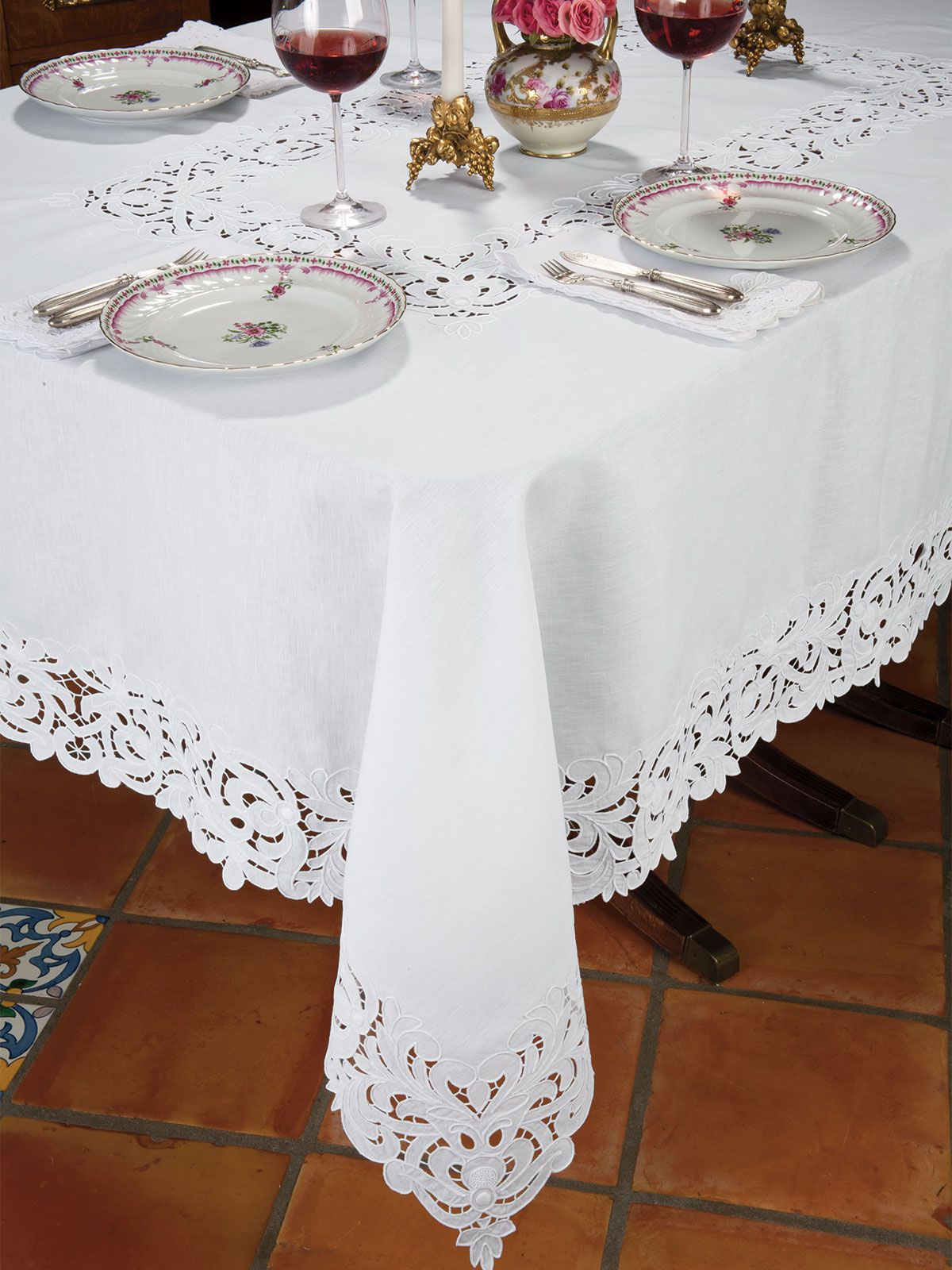 Splendor from the past, incredibly complex cutwork and hand embroidery on finest Italian linen creates a look of lavish luxury for your most elegant entertaining. Imported in majestic White on White tablecloths, placemats and napkins, all exhibit crafts­manship achieved only by skilled artisans