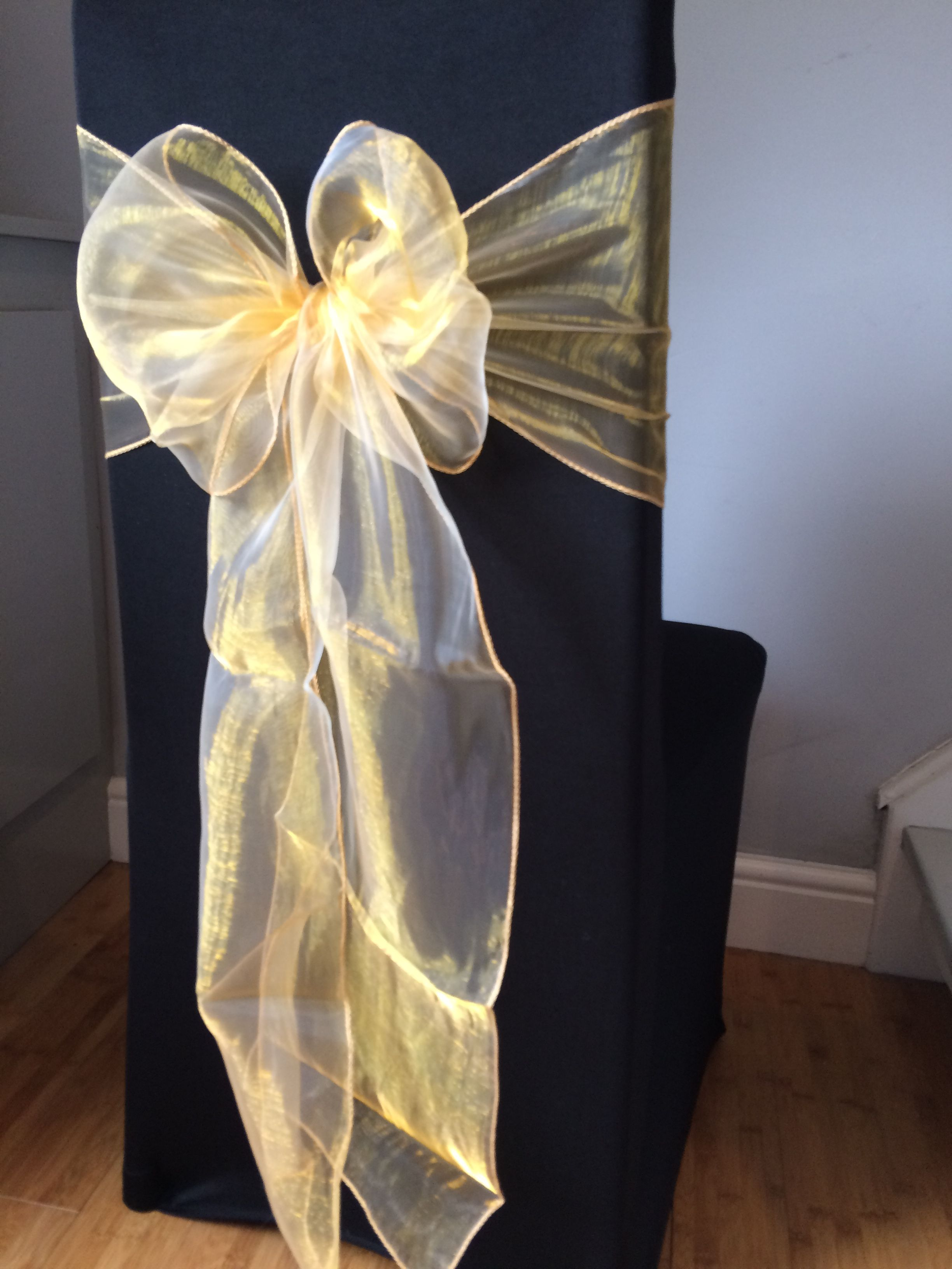 Black Chair Covers With Gold Organza Sash Available To Hire For Weddings And Events In Swansea Wedding Chair Decorations Wedding Boquet Fairy Light Backdrops