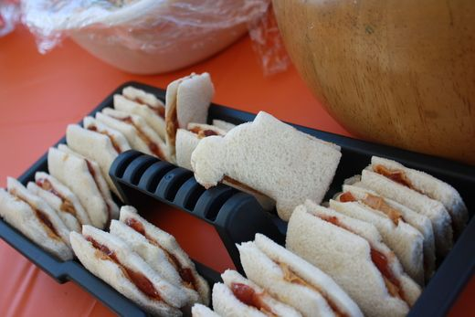 Construction themed party- sandwiches (cut into the shape of a work truck) served in a toolbox tray.