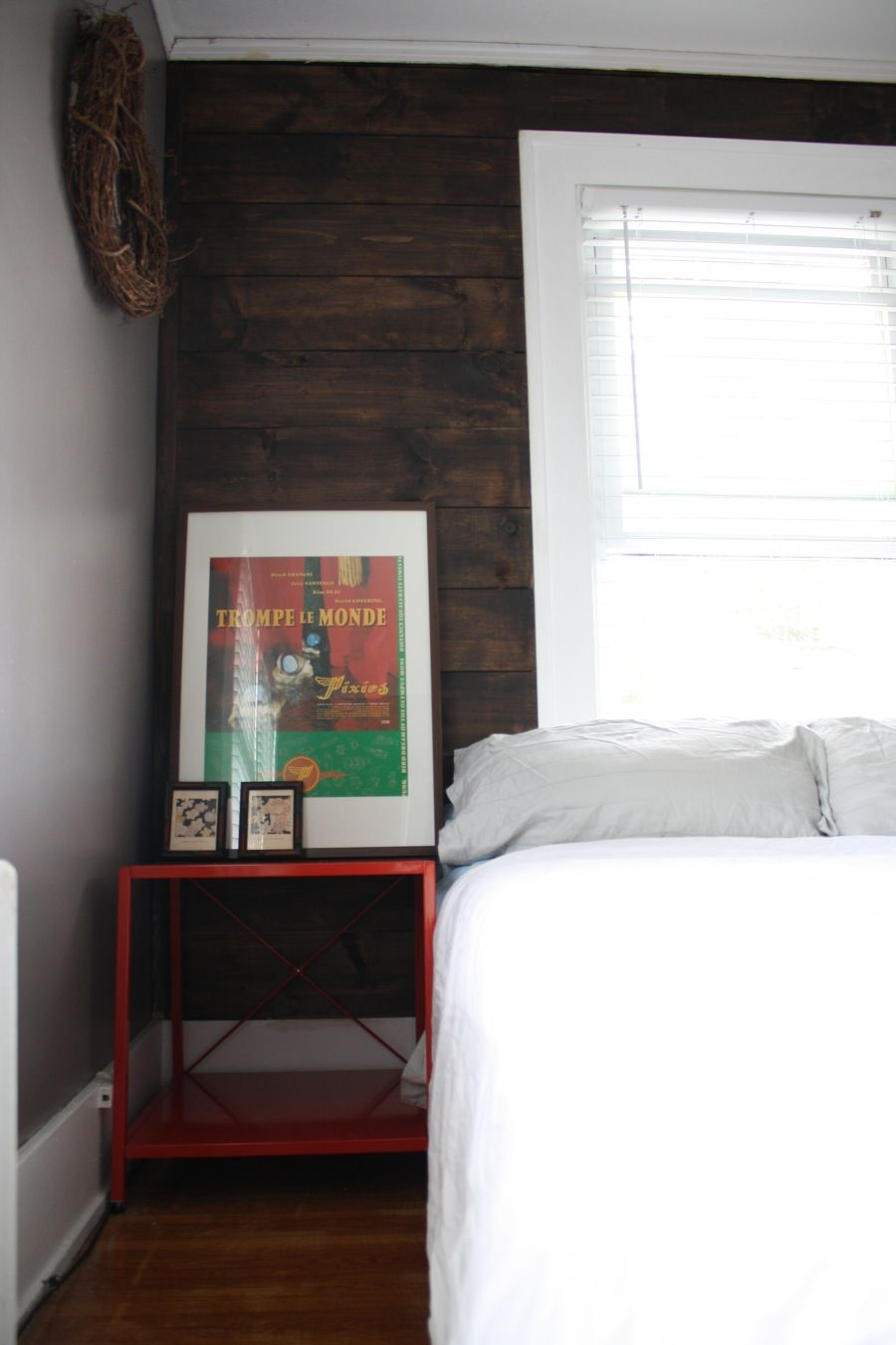 Dark walnut stained shiplap master bedroom feature wall ...