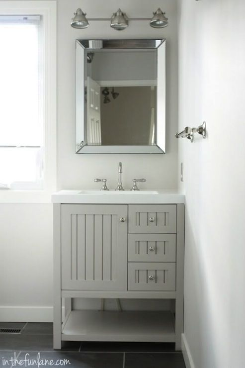Bathroom Features A Martha Living Seal Harbor 30 In Vanity Sharkey Gray With Top Alpine White Beveled Mirror Hangs Over The