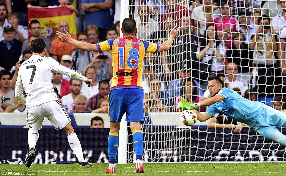 Valencia goalkeeper Diego Alves goes the right way and saves  Ronaldo's strike comfortably...