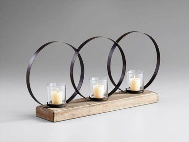 3 Circle Contemporary Iron & Wood Votive Candleholder at http://www.tuscanhomedecorandmore.com/contemporary-iron-3-circle-votive-candleholder-on-natural-wood-stand/