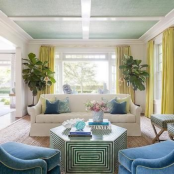 Yellow and blue living room with bone inlay cocktail table also rh pinterest