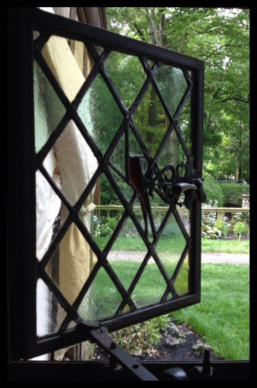 The original section of Bronwyn's house retained windows like these, with a view of the stone wall fronting the estate. #witchcottage